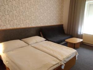 Кровать или кровати в номере Penzion Vis a Vis