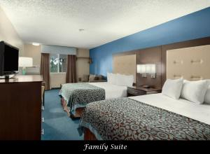 A bed or beds in a room at Days Inn by Wyndham Williams