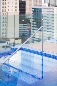 The swimming pool at or near AC Hotel by Marriott Panama City