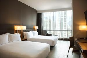 A bed or beds in a room at AC Hotel by Marriott Panama City