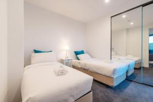 A bed or beds in a room at Astrina Garden View 2 Bedroom