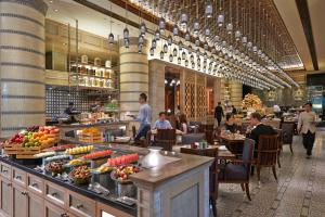 A restaurant or other place to eat at Mandarin Oriental, Kuala Lumpur