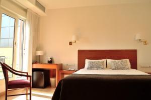 Un pat sau paturi într-o cameră la Hotel Ultonia