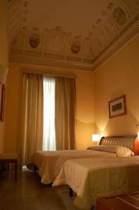 Letto o letti in una camera di Hotel Agathae
