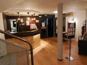 The lobby or reception area at Best Hôtel Euromédecine