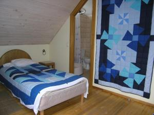 A bed or beds in a room at Ķoņu Dzirnavas
