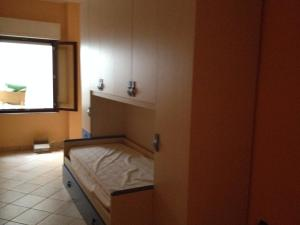 A bed or beds in a room at Buggerru a Mare Residence