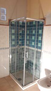 A bathroom at Buggerru a Mare Residence