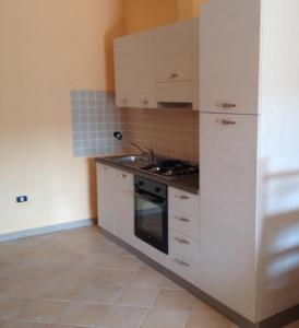 A kitchen or kitchenette at Buggerru a Mare Residence