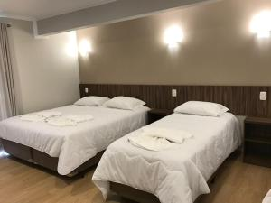 A bed or beds in a room at Hotel Villa das Termas Machadinho