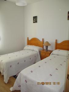 Cama o camas de una habitación en Casa El Mirador Encinar