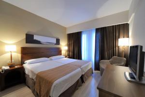 Cama o camas de una habitación en Vincci Resort Costa Golf