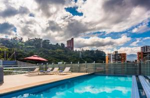The swimming pool at or near La Quinta by Wyndham Medellin