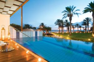 The swimming pool at or near Constantinou Bros Asimina Suites Hotel