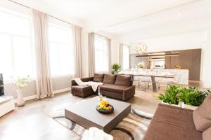 Ein Sitzbereich in der Unterkunft Residence Glamour Premium