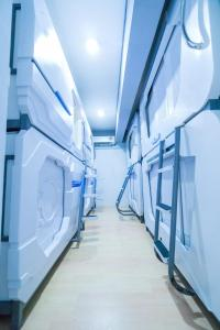 A bunk bed or bunk beds in a room at Seaview Capsule Hotel