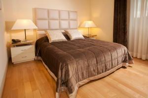 Lova arba lovos apgyvendinimo įstaigoje Hotel Piccolo Borgo