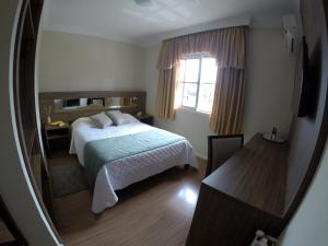 Cama ou camas em um quarto em Pousada Serra Valle