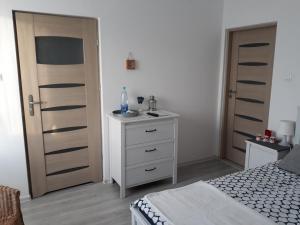 Łóżko lub łóżka w pokoju w obiekcie Willa Oliwia