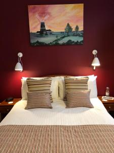 A bed or beds in a room at The Burleigh