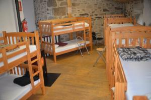 A bunk bed or bunk beds in a room at Albergue a Casina di Marcello