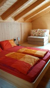 A bed or beds in a room at Tabià su'n Coi