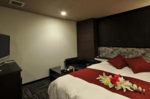 ホテル キューブ (レジャーホテル)にあるベッド