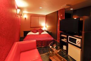 ホテル ヤーマ (大人専用)にあるテレビまたはエンターテインメントセンター