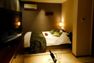 ホテル ヤーマ (大人専用)にあるベッド