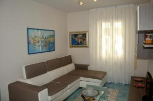 A seating area at Maiori Apartment by Marcel