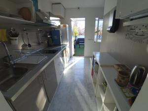 A kitchen or kitchenette at The Spot Central Hostel