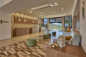 The lobby or reception area at City Express Plus Puerto Vallarta