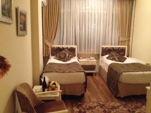 Ein Bett oder Betten in einem Zimmer der Unterkunft Tac Hotel