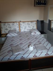 A bed or beds in a room at Hotel tenda 1