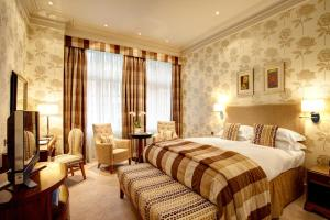A bed or beds in a room at The Chester Grosvenor