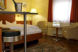 Ein Bett oder Betten in einem Zimmer der Unterkunft Apartment Hotel Kral
