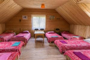 A bed or beds in a room at Atpūtas komplekss Kalves