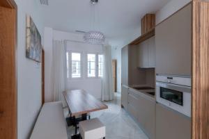 Cuisine ou kitchenette dans l'établissement Casa Gloria Apartments