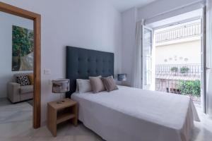 Un ou plusieurs lits dans un hébergement de l'établissement Casa Gloria Apartments
