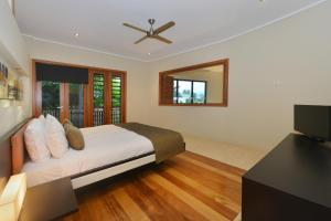 A bed or beds in a room at OneLuxe Port Douglas