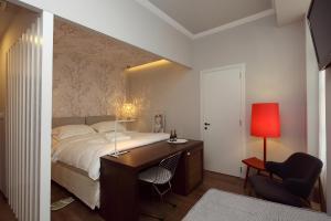 Ένα ή περισσότερα κρεβάτια σε δωμάτιο στο Hotel Metropolis
