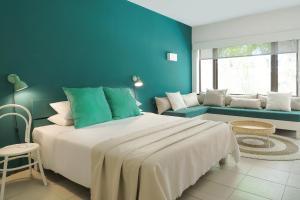 Een bed of bedden in een kamer bij Coin de Mire Attitude