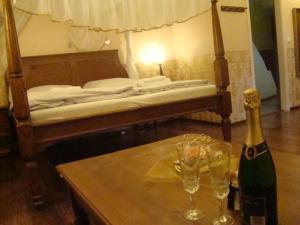 Postel nebo postele na pokoji v ubytování Zámecké ubytování U dobré hraběnky