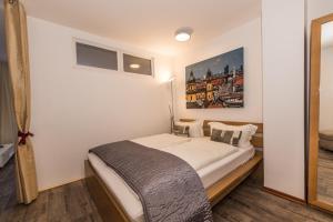 Ein Bett oder Betten in einem Zimmer der Unterkunft Westpark Apartments