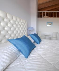 A bed or beds in a room at Kythira Golden Resort