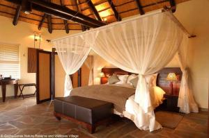 A bed or beds in a room at Gocheganas Lodge