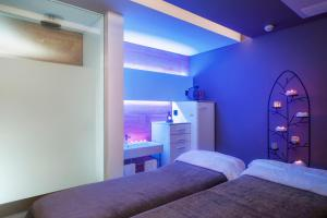 A bed or beds in a room at Sallés Hotel Pere IV