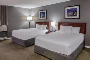 A bed or beds in a room at Hotel Faubourg Montreal Centre-Ville Downtown
