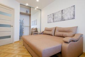 Кровать или кровати в номере Apart Petrovskie 1 on Sovetskaya 90