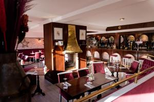 A restaurant or other place to eat at Leys Hotel